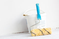 Paint bucket with roller brush on white. Royalty Free Stock Photography