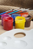 Paint buckets and brush Stock Images