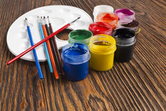 Paint buckets and brush Royalty Free Stock Photo