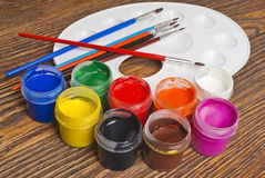 Paint buckets and brush Stock Photos