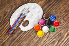 Paint buckets and brush Stock Photography