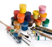Paint buckets with brushes. isolated Royalty Free Stock Photos