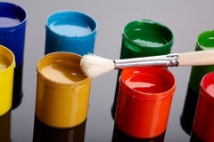 Paint buckets with paintbrush Royalty Free Stock Photos