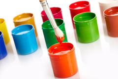 Paint buckets with paintbrush Stock Photography