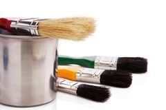 Paint buckets and paintbrush isolated on white Stock Photography