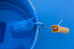 Paint can with blue color with paint roller Stock Images