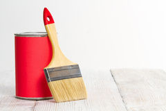 Paint Can Brush, Lacquer Wood Floor, White Wall stock images