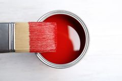 Paint can and brush on wooden background. Top view stock photos