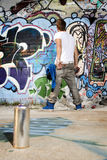 Paint can with graffiti artist behind Stock Photos