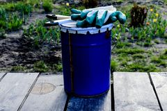 Paint can lying on the terrace of a private house with a brush and gloves, ready to be opened and painted. home repair and mainten royalty free illustration