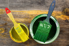 Paint can with paintbrush on the old wooden background closeup Royalty Free Stock Image