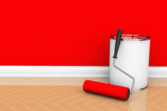 Paint can with roller brush. Painting of walls in a red color. Paint can with roller brush Royalty Free Stock Photo