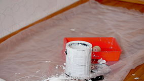 Paint can with white color and roller stock video footage