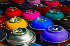 Paint cans. Background of multi-colored containers for paint royalty free stock images