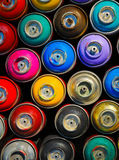 Paint cans. Background of multi-colored containers for paint stock image