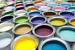 Paint cans. A colorful array of paint tins with shallow focus royalty free stock images