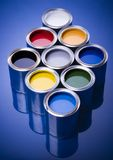 Paint and cans. Cans with paint on the blue background royalty free stock image