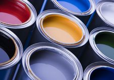 Paint and cans. Cans with paint on the blue background royalty free stock photography