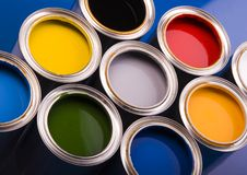 Paint and cans. Cans with paint on the blue background royalty free stock images