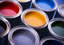 Paint and cans. Cans with paint on the blue background stock photography