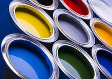 Paint and cans. Cans with paint on the blue background royalty free stock photo