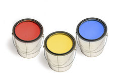 Paint Cans. Shiny paint cans full of red, yellow and blue paint isolated on white royalty free stock photos