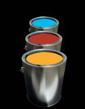 Paint Cans. Three paint cans with a black background royalty free stock photography