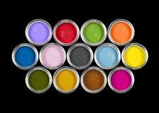 Paint cans on black. An arrangement of 13 colourful paint tins on black background royalty free stock photography