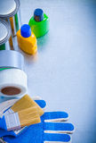 Paint cans bottles brushes duct tapes and safety Stock Images