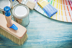 Paint cans brushes pantone fan on wooden board construction conc Royalty Free Stock Photography