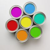 Paint Cans in a circle. A group of colorful paint cans arranged in a circle royalty free stock image