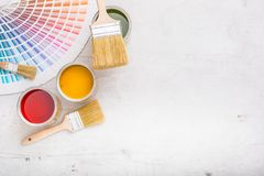Paint cans color palette, cans opened with brushes on white boar. D royalty free stock photo
