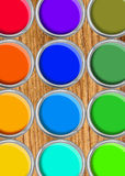 Paint cans color palette, cans opened top view on wooden table. Background royalty free stock photos