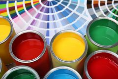 Paint cans and color palette samples on table. Closeup royalty free stock images