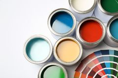 Paint cans and color palette on white background. Top view royalty free stock images