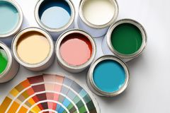 Paint cans and color palette on white background. Top view stock photos