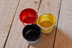 Paint cans color palette on wooden table, Red, yellow and black color on wooden table. Art blue artist background colorful house container decoration metal royalty free stock photo