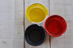 Paint cans color palette on wooden table, Red, yellow and black color on wooden table. Art blue artist background colorful house container decoration metal royalty free stock photos