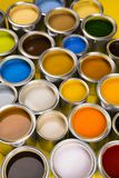 Paint cans color palette, yellow background. Full Buckets of rainbow colored oil paint on red background royalty free stock photos