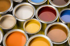 Paint cans color palette, yellow background. Full Buckets of rainbow colored oil paint on red background stock images