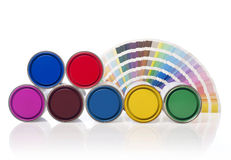 Paint cans and color swatch Royalty Free Stock Image