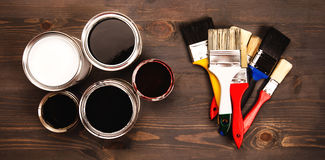 Paint cans and colored brushes Royalty Free Stock Photography