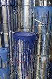Paint cans and colors. Assorted used paint cans are stacked for retail display stock images