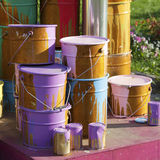 Paint cans on different colors Royalty Free Stock Image
