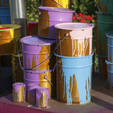 Paint cans on different colors Stock Photography