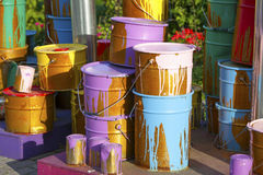 Paint cans on different colors Stock Images