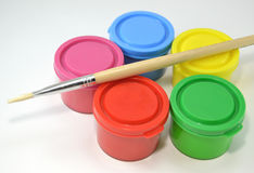 Paint cans in different colors Stock Photos