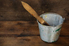 Paint cans or paint bucket on wooden background Royalty Free Stock Image