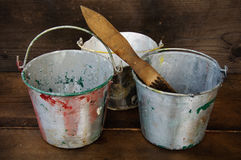 Paint cans or paint bucket on wooden background Stock Photo