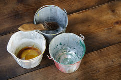 Paint cans or paint bucket on wooden background Royalty Free Stock Images